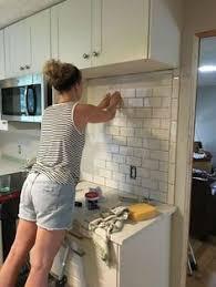 kitchen with subway tile backsplash white kitchen cabinets with white subway tile backsplash beveled