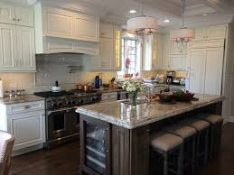 kitchen rock island schuler cabinetry sheffield door in divinity paint and eagle
