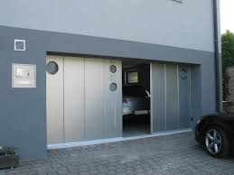elegant sliding garage doors in natural colour amaza design garage design of a modern house with blue painted walls paved driveaway and two sided sliding