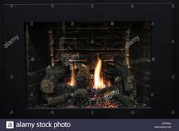 modern luxury fireplace black burning fire wood stock photo