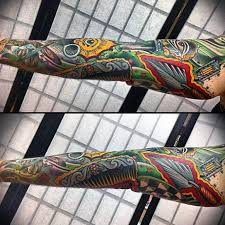colorfulful masonic tattoo on sleeve by dave vanderbemden