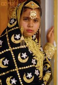 a bahraini wears a traditinal gold embroidered wedding