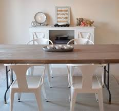 15 ways to diy your dream dining room table for half the price use an affordable folding table