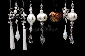 silver and white tree ornaments on black stock photo