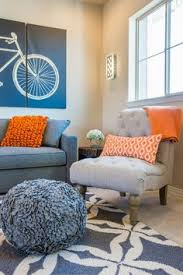 LivingRoomBlueOrangeAndBrownColorSchemeDesignCozyand - Orange living room design