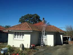terracotta tile roof restoration master roofing australia