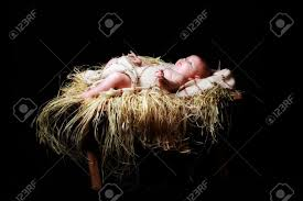 baby jesus lying in the manger stock photo picture and royalty