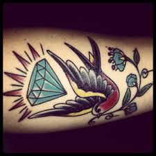 diamond tattoo neo traditional sparrow with diamond and traditional flower done by ben fitzgerald