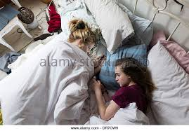 Girls In Bed by Kids Texting On Their Phones Stock Photos U0026 Kids Texting On Their