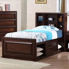 twin dark wood bed frame with open storage and drawers underneath