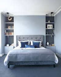 find a style that suits you both with these decorating ideas for modern blue bedroom with alcove shelving and pendants