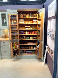 larder unit with veneered interior and oak and glass spice racks