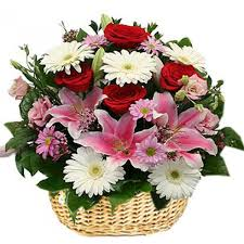 basket of flowers of mix flowers with gerberas lilies roses of different colours