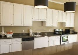 granite countertop modern kitchen wood cabinets brown glass tile