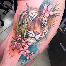 amazing pink flowers and tiger on side leg