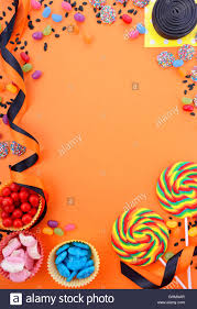 halloween or childrens birthday candy favors on a bright orange