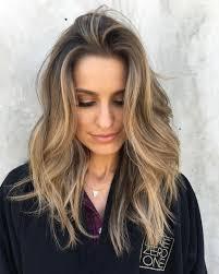dark burgundy brown hair color with layers for medium length hair