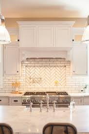 glazed brick backsplash with herringbone pattern pot filler niche