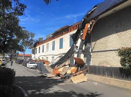 3 cars damaged when office building u0027s roof partially collapses in