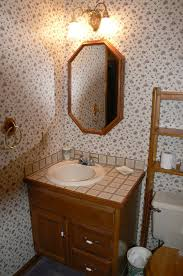 bathroom powder room ideas photos hgtv powder room vanity with open storage for towels loversiq