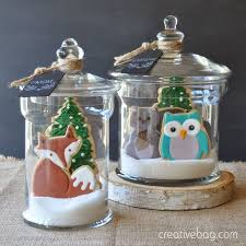 custom made woodland cookies packaged in glass containers for