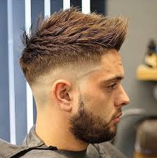 textured top faded sides men s undercut with long textured spiky fringe on brown hair with