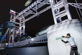land rover lego bear grylls places the final lego brick onto the worlds largest