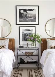bedroom with twin beds black and white photography and matching