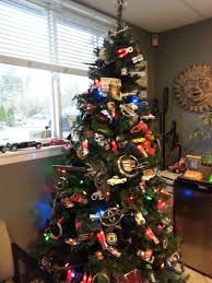 christmas tree decorated with tons of car logos has mercedes benz