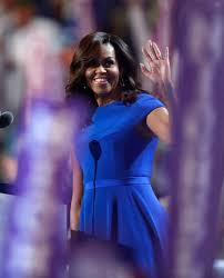 does michelle obama wear hair pieces first lady michelle obama wears royal blue christian siriano cap