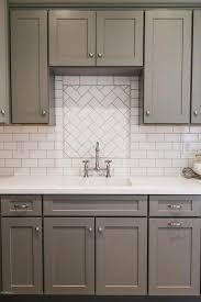 kitchen sink backsplash gray shaker kitchen cabinets with white subway tile herringbone