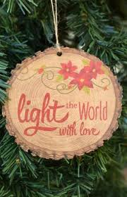 begins with wood slice ornament from