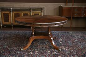 Round Dining Table Extends To Oval Dining Room Rounded Brown Varnished Oak Wood Dining Table With