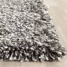 living room gray shag rug with brown ceramic floor and small