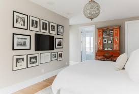 Bedroom Bed In Front Of Window Deluxe Gray Living Room Sofa And Round Glass Table Infront Of