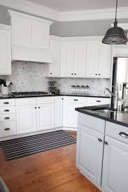 white kitchen cabinets with hexagon backsplash kitchen cabinets black counters white backsplash page 4
