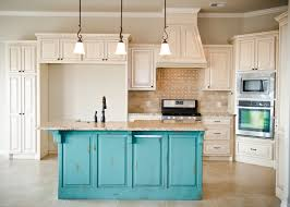 best ideas about custom kitchen islands pinterest dream distressed turquoise island with cream glazed cabinets stone mosaic backsplash