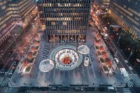 a rockefeller center plaza is dramatically transformed in a new