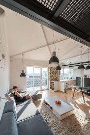industrial loft apartment in bratislava exhibiting warm vibes
