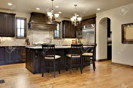 dark wood kitchen with granite counters stock photo picture and