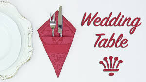 how to fold napkins for a wedding wedding table decoration fold a cutlery sleeve out of a