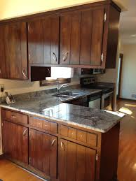 what color paint goes with brown cabinets need help with cabinet paint color to match awkward granite