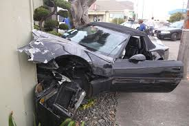 corvette car crash crash 1990 corvette collides with toyota and a hotel wall in