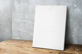 wood canvas blank white canvas frame leaning at concrete wall and wood floor