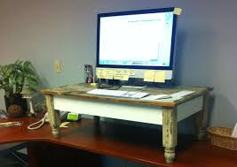 Standing And Sitting Desk by Taking A Stand Standing Desks An Antidote To Sitting Disease
