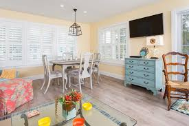 open concept cottage kitchen tropical with track lights casual