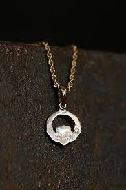 galway ring claddagh ring earring turned necklace diana elizabeth