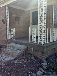 do you remember our dark green wrought iron oak motif porch