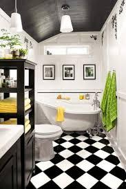 small bathroom with clawfoot tub and diamond shape floor tiles