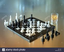 White Chess Set A Black And White Chess Set Made Of Marble With Glass Of Whiskey